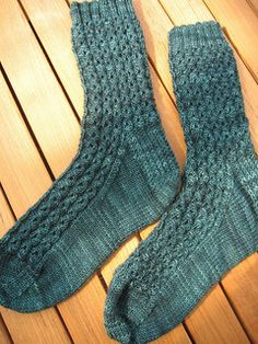 "From pattern: ""A simple sock pattern with an easy-to-memorize stitch. Looks good in either self striping fingerweight yarn or solid colors. This is a mock cable because you don't actually need to do any cabling, it's just a matter of yarn overs and slipping stitches."""