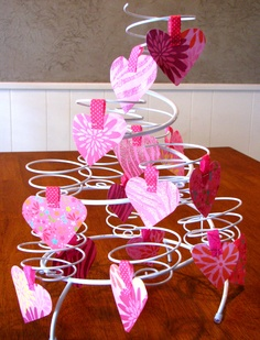 """Every time your child does something kind for someone else, let them hang a heart (or shamrock, or Easter egg, or flag, or pumpkin, etc) on the """"kindness tree."""" It gets them motivated to do kind deeds for others! I found my """"kindness tree"""" at Walmart - it's really a wire cupcake holder. You could also use a miniature Christmas tree."""