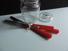 Three Delightful Pieces of Bakelite Stainless Steel Flatware. Two Knives and one Fork in Delicious Cherry Red with a Dainty White Trim.    This