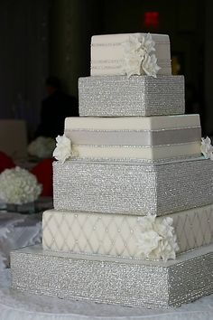 LOVE this wedding cake! The different patterns of silver glitter make it sophisticated and fun all in one!