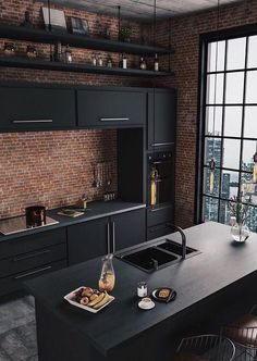 Kitchen Industrial Decor with Exposed Brick - black countertops, brick wall backsplash, black kitchen fixtures, and concrete floors. This is a beautiful industrial kitchen design! Interior Design Blogs, Interior Design Kitchen, Interior Design Inspiration, Home Design, Design Design, Design Trends, Design Concepts, Bathroom Inspiration, Interior Ideas