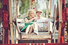 couple on ferris wheel in carnival engagement session