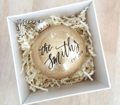 ETSY Personalized established NEWLYWED CHRISTMAS ORNAMENT gift with calligraphy - One (Gold) A couple's last name with their established date is hand lettered onto the ball in black paint. Personalized Christmas Ornaments, Diy Christmas Ornaments, Christmas Projects, Holiday Crafts, Christmas Decorations, Handmade Ornaments, Holiday Decor, Homemade Christmas, Christmas Ideas