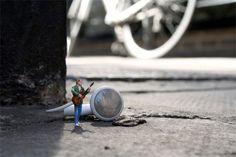 Creative art project by Slinkachu features tiny people strategically placed on the streets of European cities for everyone to discover and enjoy.