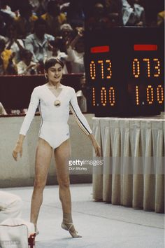 Nadia Comaneci of Romania is awarded a perfect ten after her routine on the uneven bars during the Women's artistic team all-around event on 18 July 1976 during the XXI Olympic Summer Games at the Montreal Forum, Montreal, Canada.