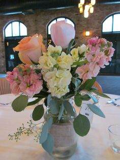 We carry Ball jars with burlap as a complementary rental. They look amazing with soft pastel flowers. Great vintage style!