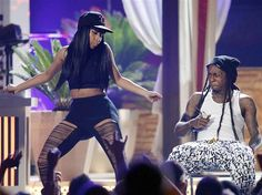 """Lil Wayne looks a """"lil"""" uncomfortable as Nicki Minaj struts her way over to him - was this before or after she straddled him while performing High School? ..... Link takes you to the best and worst moments from this year's (2013) Billboard Music Awards. (© Steve Marcus, Reuters)"""