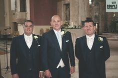 The groom and his groomsmen as they wait in the church for the girls to arrive. Weddings at The Johnstown Estate, photographed by Couple Photography.
