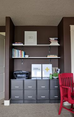 shelving and decorative brackets. filing cabinets. love the red chair also.