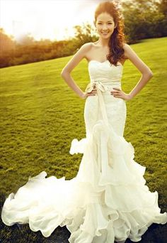 French lace mermaid style royal princess wedding dress -- and I'm liking the side swept hair!