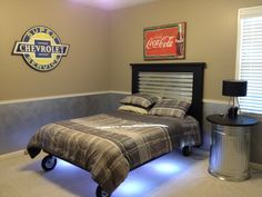 American Pickers / Industrial Bedroom Teenage boys room. LED lit bed on casters with a galvanized head board. Also a trash can side table with a chalk board top.