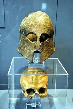 Corinthian Helmet from the battle of Marathon (490 BCE). Uncovered,  with the skull of the Greek warrior intact.