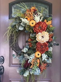 Cascading flowers create a dramatic fall wreath Wreath Crafts, Diy Wreath, Door Wreaths, Grapevine Wreath, Autumn Wreaths, Holiday Wreaths, Wreath Fall, Fall Crafts, Fall Decor