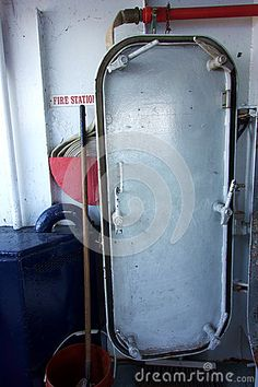 Photo about A classic boat deck scene of a mop in a bucket leaning against a fire hose coiled up and a steel water tight door on the deck of a US ferry. Image of ferry, water, tight - 73566375 Classic Boat, Fire Hose, Steel Water, Tights, Bucket, Deck, Industrial, Scene, Stock Photos