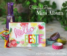 Simple DIY Cereal Box Mini Album made from cereal boxes, scrapbooking paper and stickers