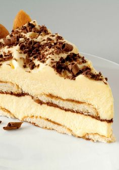 Easy Tiramisu Pie -- Two of your dessert favorites wrapped into one! Layers of creamy pudding paired with vanilla wafers and drizzled with coffee.