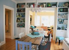 How do you get more storage out of a small space? Build bookcases - with cabinets - around a doorway.