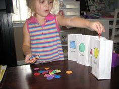 Quick and simple way to review shapes...  I found these little white bags at Michael's, then simply drew the desired shapes on the front.  I...
