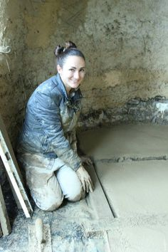 Installing an Earthen Floor into Our Cob Cottage was muddy work! We started with a thick layer of pummus to act as insulations, then added a vapor barrier and then went onto the cob floor. Cob Building, Green Building, Building Design, Building A House, Building Ideas, Earthship Home, Mud House, Clay Houses, Natural Homes
