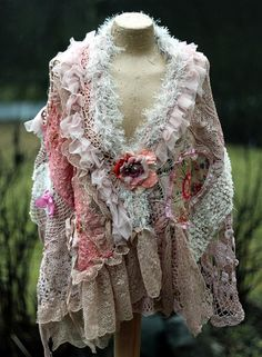 Bold shabby chic asymmetric cape/shrug is made of antique handmade laces dating back 1920-30.The laces are hand dyed in shade of blush, cream,