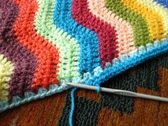 crochet edging on side of ripple afghan: 2 singles (or doubles) in each space