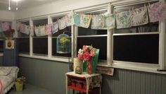 I took hankies and made a swag valance. They are held up by old clothes pins. Simple and cheap way to add some whimsy.