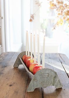 A beautiful + simple centerpiece using apples and taper candles