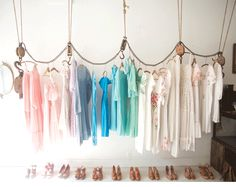 Hang clothes on pulleys. I could see this for an exposed closet or a kid's dress-up area.
