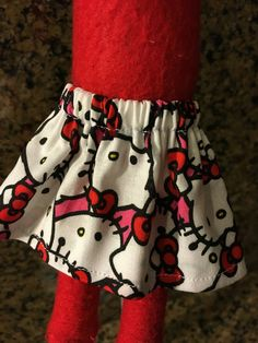 Handmade Elf on the Shelf Skirt:  This skirt has an elastic waist and was made to the fit the popular red Christmas Elf doll. The skirt is 2.5 inches long. Skirt with Hello Kitty all over.