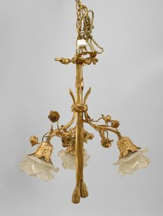 French Louis XVI style gilt bronze chandelier with embellished with flowers and centered with a drape ending in tassels with 3 arms ending with glass flower shades Black Wall Sconce, Indoor Wall Sconces, Rustic Wall Sconces, Candle Wall Sconces, Floral Chandelier, Bronze Chandelier, Antique Chandelier, Victorian Furniture, Antique Furniture