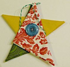 This simple fabric star Christmas ornament is so charming! Perfect craft for adu is part of Simple Kids Crafts Fabrics - This simple fabric star Christmas ornament is so charming! Perfect craft for adults as well as kids! Quilted Christmas Ornaments, Christmas Sewing, Christmas Diy, Simple Christmas, Traditional Christmas Ornaments, Recycled Christmas Decorations, Christmas Fabric Crafts, Christmas Quilting, Christmas Music