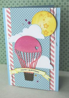 A bright and cheery birthday card using your silhouette cameo and distress inks