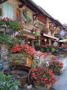 Yvoire, France - described as one of the most beautiful cities in France, Yvoire is known for its stunning flower displays during the summer months.