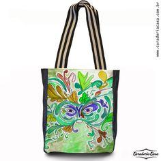 Mascara, bolsa tote da coleção Fantasias, produzida a partir das aquarelas de Aline Pascholati. O objetivo da artista é mostrar o lado mágico da vida, a partir de personagens enigmáticos e imagens bem coloridas.