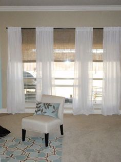 sheer curtains and bamboo blinds .. love the sheer linen mixed with bamboo shades .. would have installed them higher but like this look