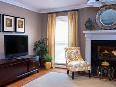 Gray Transitional Living Room With Soft Yellow Cur
