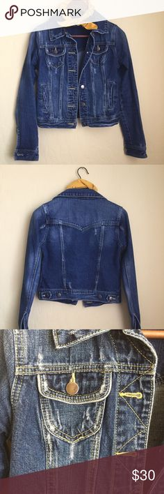 Distressed Denim Jacket Slightly distressed denim jacket. Hits right at the hips. In great condition! Would be perfect to throw over a sundress or used for layering in the winter. Jackets & Coats Jean Jackets