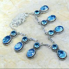 Quartz blue topaz dangly necklace Gorgeous deep blue sparkly stones set in Sterling plated silver. Jewelry Necklaces