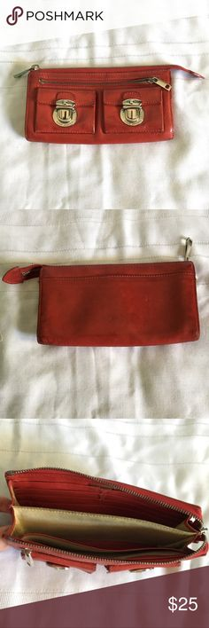 """Marc Jacobs Red Leather Wallet Marc Jacobs Red Wallet with silver hardware. This Wallet has A LOT of space with 2 small front pockets and a zipper pocket on the front, 4 compartments on the inside, 6 card slots, and a pocket in the back. The leather on this Wallet is worn in but still very pretty. Approximately 4"""" H x 7.5"""" W Marc Jacobs Bags Wallets"""