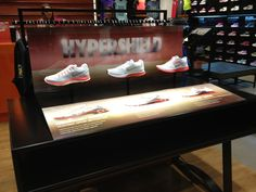 Nike Hypershield - retail table display sports in-store shoe display.