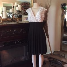 Dress Black and white bodice with full A-line black skirt. Flows beautiful. Connected Dresses