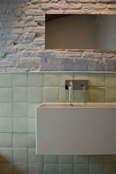 Painted brick and green tile in studio apartment bathroom in Italy - Designed by Mantova-based multidisciplinary design firm Archiplan Studio - On Remodelista Bad Inspiration, Decoration Inspiration, Bathroom Inspiration, Interior Inspiration, Interior Ideas, Decor Ideas, Bathroom Toilets, Laundry In Bathroom, Bathroom Wall