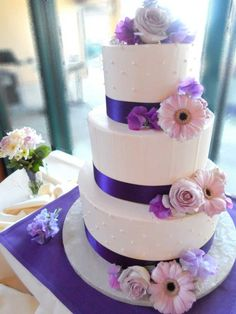 simple classic buttercream wedding cake with stripes and dots #elegantwedding