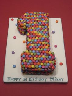 Google Image Result for http://www.completelycakes.co.uk/wp-content/uploads/2010/02/Number-1-with-Smarties-covered-board-e1268231737146.jpg