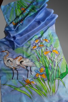 Hand painted silk scarf. Blue scarf with herons. Bird scarf. Designer scarf. Made to order. It will take me about 10 days to make the scarf. 18x69inches (175 X45 cm) It is made of 100% pure silk in a non-smoking environment. I used professional dyes and steam to fix the colors. So this scarf will serve you many years without fading. The scarf is as light as a feather and drapes beautifully around your neck and shoulders. You can wear it as a wrap with your evening dress as well. Natural s...