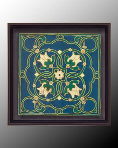 Antiqued Cloisonne VI by John-Richard: Italian Tile Design In Emerald And Sapphire With Details In Ochre Yellow And Cream. Reproduced Giclee With Hand Finish. Mounted On Board Set Above Hand Finished Background In Textured Metallic Smoke Grey. Gallery Frame In Darkened Antique Bronze #ColorOfTheYear