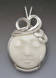 Carved Full Moon Face Cameo Cow Bone Bali Sterling Silver Wire Wrapped Pendant on Etsy, $32.00