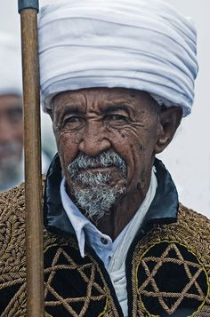 Ethiopian Jewish man with gorgeous embroidered coat.
