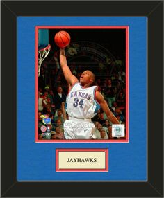 One framed 8 x 10 inch University of Kansas photo of Paul Pierce with a customizable nameplate*, double matted in team colors to 11 x 14 inches.  $49.99 @ ArtandMore.com