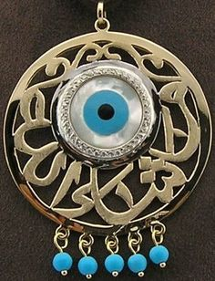 """God willing"" written in calligraphic Arabic around the ""Evil eye"". Serves as a protection from jealous people! Arabic Jewelry, Evil Eye Jewelry, Illuminati, Istanbul, Greek Evil Eye, Turkish Eye, Evil Eye Pendant, Evil Eye Charm, Hamsa Hand"